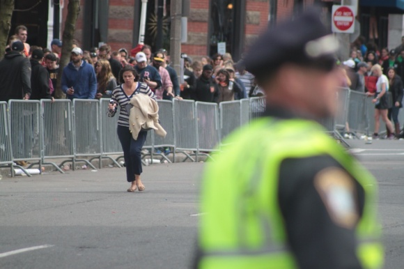 A spectator runs away from the scene of the explosions along the marathon route.
