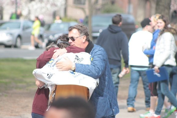A family reunites with a runner after the explosion.