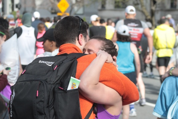 A runner who was stopped before she could finish the marathon reunites with loved ones on Commonwealth Ave.
